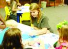 Cotton Blossom Savanna Hatten does Community Service at Richland Parish Library in Rayville. She helped the children with their arts and crafts and listened to the story time. She attends Delhi Charter School.